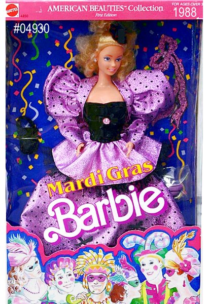 Mardi Gras Barbie  doll wears a gorgeous purple and black masquerade costume featuring a  jacket with pouffed sleeves, matching long skirt, and black bodice. Her  long skirt and jacket can be removed for a more striking ensemble  featuring just the black bodice and a short purple skirt. Her blond hair  is curled in ringlets, and pulled gently up and away from her delicate  features.