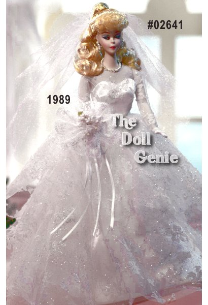 This Porcelain Wedding Party Barbie doll wears a lovely reproduction of the 1959 Wedding Day fashion. Her lacy gown, veil, and accompanying flowers make this doll a stunning bride. Barbie has the rn  original face makeup with white irises, and the famous blond ponytail. Designed by Janet Goldblatt