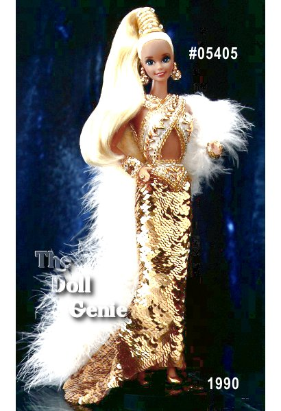 Fitted in a daring gown of 5000 hand-sewn golden sequins accented with a white feather boa, Gold Barbie is a vision of fantasy couture. Her platinum blonde hair is pulled up, and accented by a golden headpiece. Golden earrings and bracelets accent this incredible  ensemble.