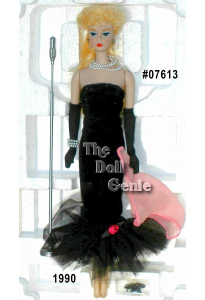 In a fitted black sheath gown that flares at the hem, Barbie doll recreates the popular 1960 Solo in the Spotlight fashion. Simple yet elegant, this wonderful reproduction features Barbie with a blond ponytail and vintage face paint. A single red rose accents her flared tulle flounce, with additional details including black pumps, long black gloves, a pink scarf, and three strands of faux pearls around her neck.
