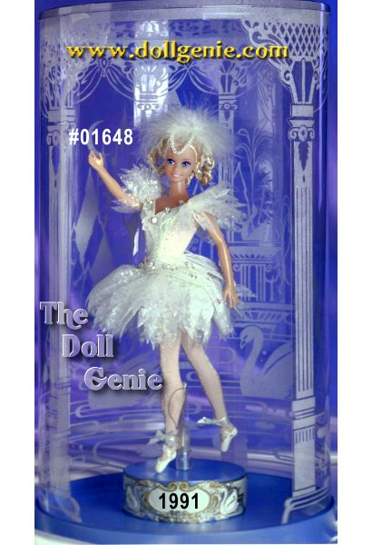 Barbie doll is the beautiful Swan Queen from Tchaikovskys ballet Swan Lake. She exudes grace rnand charm dressed in a stunning white ballet costume complete with fitted bodice, layered tulle skirt, and matching sleeves. White ballet shoes, tights, and matching feathery headdress accent this adorable ensemble. Dolls blond hair is twisted into individual ringlets that perfectly compliment her stunning face paint. Her arms are specially sculpted to achieve ballet-like poses. Doll comes with a wind-up music box that plays music from the actual ballet. Swan Lake Barbie rotates on the music box as the music plays.