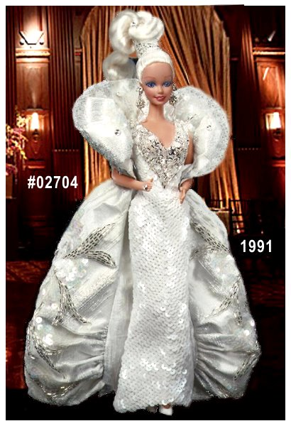 Limited Edition, Third in the Mackie series, Platinum Barbie wears a fabulous platinum-white gown and brocade coat featuring over 8000 hand-sewn sequins, beads, and crystals. Her platinum blonde hair is twisted into an exquisite updo, accented by jewels.