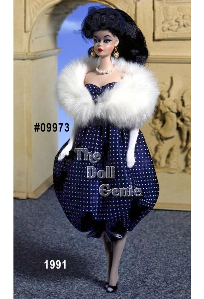 An all-time favorite with collectors, here is the charming Gay Parisienne fashion. Its the classic dark blue bubble dress with tiny white polka dots. Fabulous accents include long white gloves and a faux fur stole, a veiled headband hat, navy open toe shoes, and a faux pearl necklace and golden velvety clutch. Barbie dolls demure vintage look is back with those lovely side-glancing eyes, red lipstick, painted finger and toenails, and a ponytail with curled bangs.