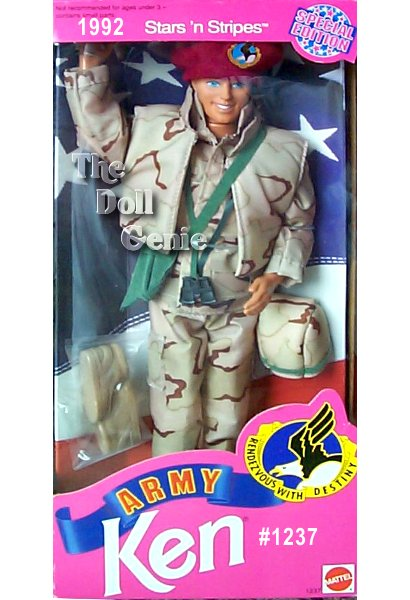 Stars and Stripes Army KEN Doll in authentic desert battle uniform of camouflage material. Ken wears a camouflage jacket, pants, and vest, green over-the-shoulder bag, and maroon beret.