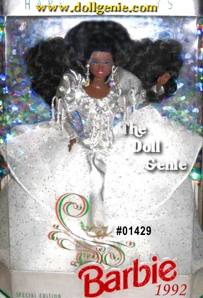 Barbie is ready for the holiday season, dressed in a luxurious, silver lam gown. The many layers of her tulle skirt are accented with holographic glitter, and shimmering beads dangle from the bodice. Silvery earrings and a silvery jewel-accented hairband create the finishing touches to this festive ensemble. African American Version