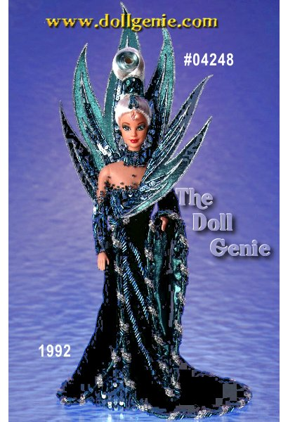 Limited Edition - Fourth in the Bob  Mackie series, Neptune Fantasy Barbie doll appears as a vision of oceanic splendor. Wearing a blue and green sequined and velvet gown, Barbie is surrounded by accents of sea waves. Her platinum blonde hair has a turquoise streak in it, and is tied on top of her head, accented with a turquoise sequined headpiece. This is the first doll in the Bob Mackie  collection to feature closed mouth sculpting. This doll has never been removed from the original box.