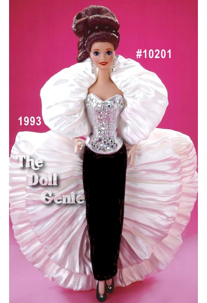 Limited Edition - Crystal Rhapsody Barbie doll wears a silver bodice adorned with Austrian crystal rhinestones, a black silk velvet skirt, and a fabulous white pleated satin crepe coat. Her hair is piled on stop of her head, adorned with a black and silvery head band. This porcelain doll was an extremely limited edition produced specifically for the 1993 Disneyland Teddy Bear and Doll Convention.