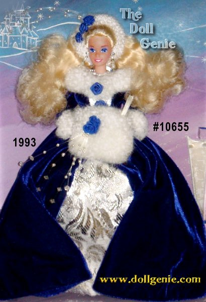 Barbie doll appears both elegant and cozy in this wintry ensemble! Wearing a blue velvety dress with a silvery inset front panel and white faux fur accents, she celebrates the impending snow flurries with style. Her long blond hair falls in billows about her shoulders, and is accented by a faux fur hair band with blue rose.