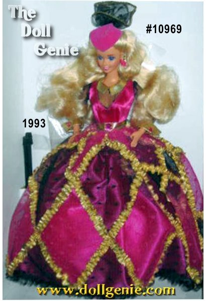Barbie has blonde waist-length hair and blue eyes.    She wears a black and fuchsia gown that is trimmed with a gold ruffled ribbon that forms a diamond design over the skirt. The fuchsia bodice has a black tulle inset and long black tulle sleeves.    A fuchsia hat topped with black tulle matches the gown.    Accessories inclue earrings, a ring and pumps. Doll stand and a hair brush are included.
