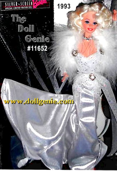 This glamorous doll wears a Mae West inspired full on silver fishtail evening dress with matching arm gauntlets, accented with iridescent glitter netting at bodice, waist, hips, 3 sparkling rhinestone & silver buttons accent these net highlights. Barbies skin tone is peachy with beautiful blush, a tiny beauty mark is above her left side lip, real rooted & curled eyelashes. Her earrings & ring are shiny silver plastic studs carved in a diamond style (plastic no green ear) necklace a collar of tiny rhinestones - she has on a white marabou shrug in addition to the evening dress she is wearing, a white satin teddies and same trimmed net robe are included for her to relax in - included are white mule shoes.