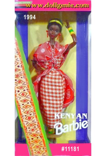 Kenyan Barbie doll is dressed in a traditional Masai moran (warrior) costume. Her dress, called a shuka, is red and white checked. Draped over her dress is a gorgeous kanga red cape with patterned white designs, accented by an elaborate  multi-colored collar. Her accessories include matching bracelet, anklet, and red earrings.
