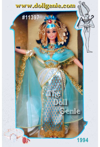Barbie doll is an  Egyptian queen in this royal costume capturing the essence of Egypts Golden Age. She wears a dress including a white pleated skirt with golden trim, blue and golden front panel and flowing turquoise cape with golden edging. An intricately detailed golden headdress with turquoise beading reflects that she is indeed Egyptian royalty.