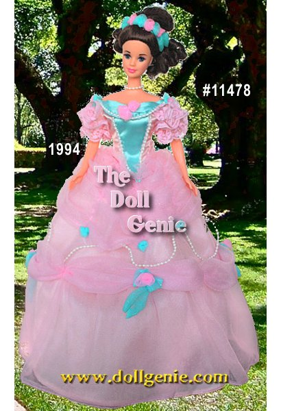 Barbie doll makes a lovely southern belle in this beautiful pink gown with turquoise-blue accents. Ruffled sleeves, full skirt adorned with rosettes and faux pearls, and a beautiful headband with turquoise and pink rosettes adorn this delicate costume. Dark hair and faux pearl choker create a dramatic contrast to the rest of Barbie dolls costume.