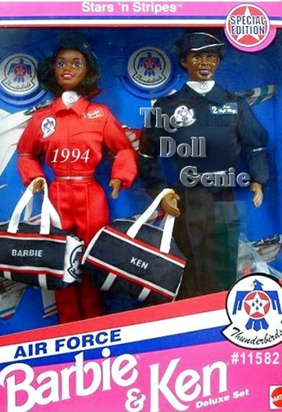 Barbie and Ken dolls join forces to serve their country in this patriotic gift set. Barbie sports a red flightsuit with navy flight cap and matching duffel bag with red and white stripes. Ken wears a navy flightsuit with matching flight cap and duffel bag. Dolls come with Thunderbirds insignia on their flightsuits and white scarves. African American Version
