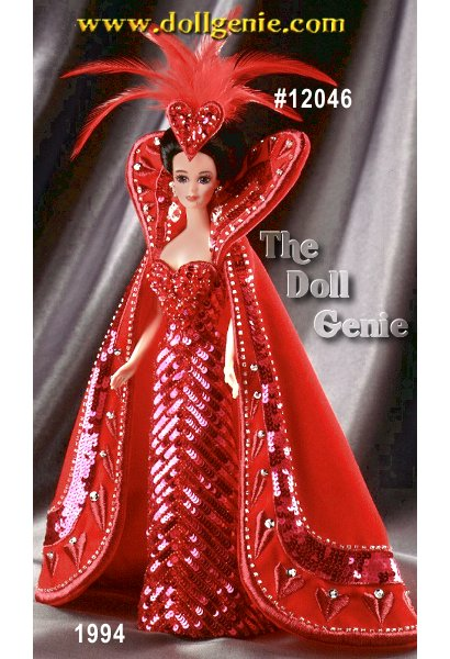 Queen of Hearts Barbie wears a luscious red ensemble featuring a gorgeous sequined gown, heart-embroidered cape, and fanciful headdress, all offset by her stunning features and dark upswept hair.