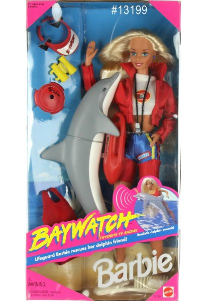 1994 Baywatch Barbie comes with: Lifeguard Shorts, Midriff T Shirt & Windbreaker, Baywatch Paddle Float, Dolphin, Swimsuit , Sun Visor & Brush