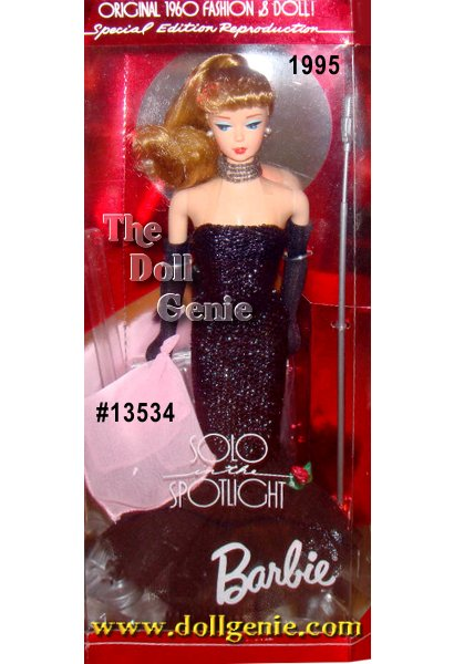 In a fitted black shimmering sheath gown that flairs at the hem, Barbie doll re-creates the popular 1960 Solo in the Spotlight fashion. Simple yet elegant, this wonderful reproduction features Barbie with a blond ponytail and vintage face paint. Additional details include black pumps, long black gloves, a pink scarf, and a four strand faux pearl necklace. What a stunning reproduction!