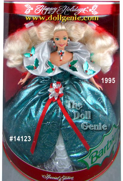 Barbie doll wants to wish you happy holidays! In a very festive green holly-printed dress with a silvery Victorian collar, Barbie personifies the charm of the season. Her ensemble is accented by red rhinestone berries, a poinsettia sash, jeweled choker and a red poinsettia in her hair.