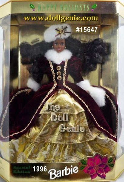 In a charming burgundy velvet coat trimmed in luxurious white faux fur, Barbie doll welcomes the holiday season. Underneath her lovely velvet coat is a golden-tiered skirt. A gorgeous white faux fur muff and hat match the fur accents at her collar and sleeves. African American Version