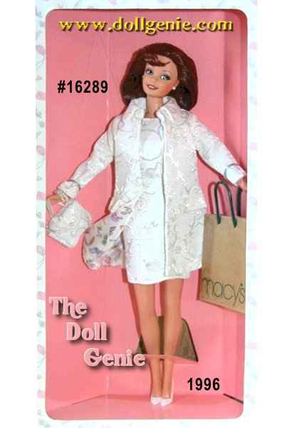 Barbie doll shows her fashion sense in a fabulous Nicole Miller ensemble designed exclusively for Macys. Barbie is wonderfully chic in an off-white jacquard coat with matching slim, sleeveless dress in the same fabric. Her striking coat is lined with a muted pastel Nicole Miller silk print of signature Barbie icons. Accessories include a white handbag, white pumps, faux pearl bracelet, and of course, a Macys shopping bag. With her auburn hair color and green eyes, this Limited Edition doll makes it apparent why both Barbie doll and Nicole Miller are such big stars.