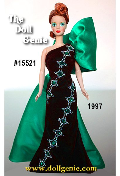 Jewel Essence  Collector Edition - Green has never looked so good. Meet Emerald Embers Barbie doll from the Jewel Essence Collection by Bob Mackie. Every doll in the collection sparkles in the color of a jewel and is adorned with beautiful Swarovski crystals. Here, Barbie, embraced in deep emerald green, glows like a jewel of the Amazon. Her eyes seem to smolder like the crystal rhinestones on her dress. Poised and regal, she is a tribute to the jewel of kings.