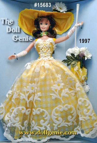 Summer Splendor Barbie doll will delight your eyes like a field of daisies on the clearest of summer days. Her crisp yellow and white gingham-print dress is complemented by a shimmering white, flocked overskirt. Her beautiful face is shaded from the summer sun by a sumptuous hat with colorful strawberry and daisy decoration. Every detail is perfect, down to her matching parasol, also accented with strawberries and daisies. Her dark, flowing hair has been lovingly styled to highlight her delicate face.