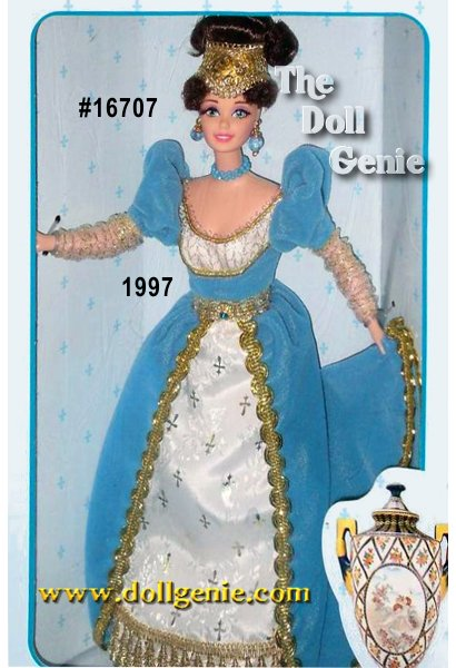 Behold the exquisite French Lady Barbie doll in a gown that was all the rage in Napoleons court. Its empire styling  mimics the elongated elegance of a classical Greek column; its predominant color is French blue, a color much favored by royalty in France. The underskirt is dotted with golden fleurs-de-lis, a long-lived symbol of French royalty. French Lady Barbie, from the Great Eras Collection, has hair gathered into a golden mesh headpiece and her lovely face is trimmed in tiny chestnut curls. Her skin is fair, her eyelashes rooted, while her faux turquoise jewelry complements the French blue of her gown. She truly captures the magnificence of the great Napoleonic Age.