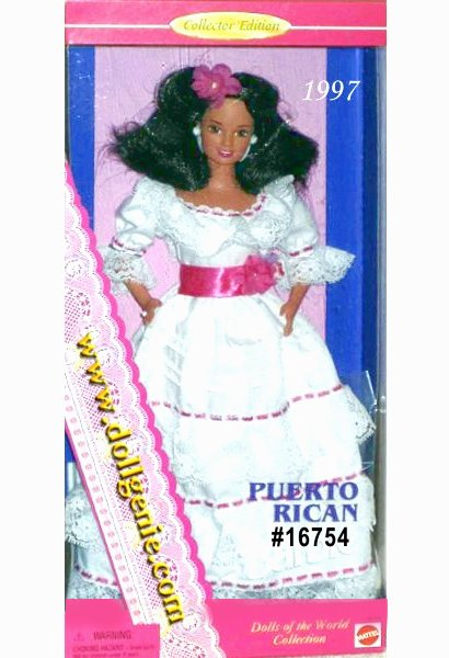 Say hola, or hello, to beautiful Puerto Rican Barbie doll from the Dolls of the World Collection. She wears a long white cotton dress trimmed with lace, pink ribbon and floral adornments. Her skirt has lace ruffles trimmed with a pink border. She also wears a wide pink ribbon around her waist that is accented with a flower. Her long, wavy brown hair is adorned with a pink flower. Her accessories include earrings, a ring and shoes.