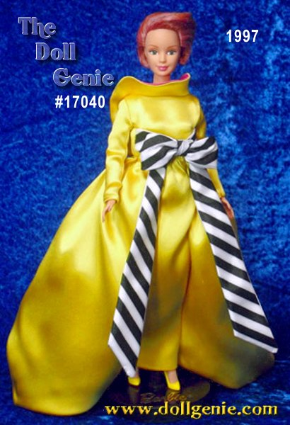 A creation of genius from famed American designer Bill Blass. With his signature dramatic flair and style, he has created a gown just for Barbie doll that combines vibrant color and contrasting pattern. The gown is lined completely in bright fuchsia and has a fuchsia underskirt for added fullness. Her unique hairstyle and face paint complete the couture styling. With its dramatic train and back, the gown is truly made for Barbie in a way that only Bill Blass could have imagined.