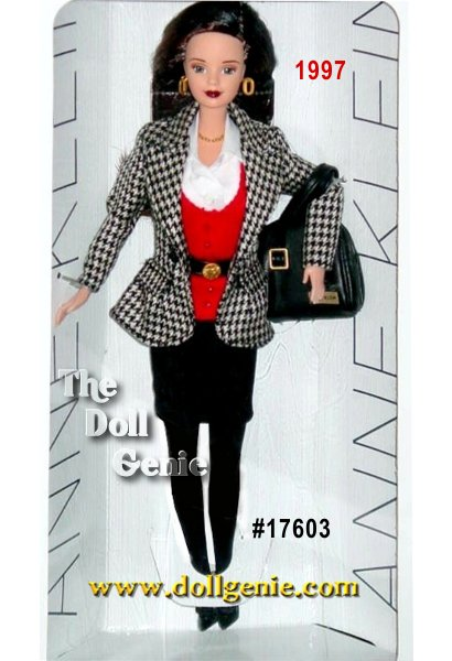 Anne Klein brings yet more class to the Barbie Collectibles line with this doll. In typical Anne Klein fashion, Anne Klein Barbie doll is smartly attired for a day of high-powered and high style business. She is wearing a black skirt, black stockings, white dickey, red knit vest, and a black and white houndstooth jacket. Accessories include a black belt with a lion head buckle, chain link gold tone necklace and gold tone link earrings, black purse with Anne Klein logo and black pumps. Her beauty is matched only by her classic professional appearance.