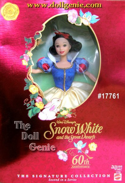 Disney Collector Edition  The Signature Collection   Walt Disneys Snow White and the Seven Dwarfs 60th Anniversary     This Snow White Figure is Barbie Size and is dressed in her beautiful signature gown of Royal Blue brocade and yellow satin charmeuse enhanced with details like the white satin collar, golden braid trim, beads, shoes with delicate bows, and a lacy petticoat.