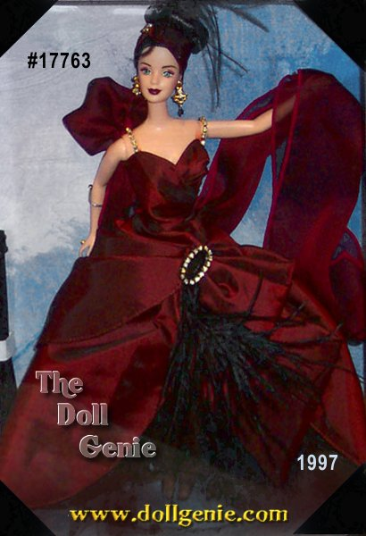 Moonlight Waltz Barbie looks sensational in a brick red taffeta gown with black tulle and sequins, and a chiffon shawl. Her dark hair is styled into an elegant upsweep, accented by a pleated headband with black feathers. Rhinestone drop earrings add a glamorous touch to this delightful doll.