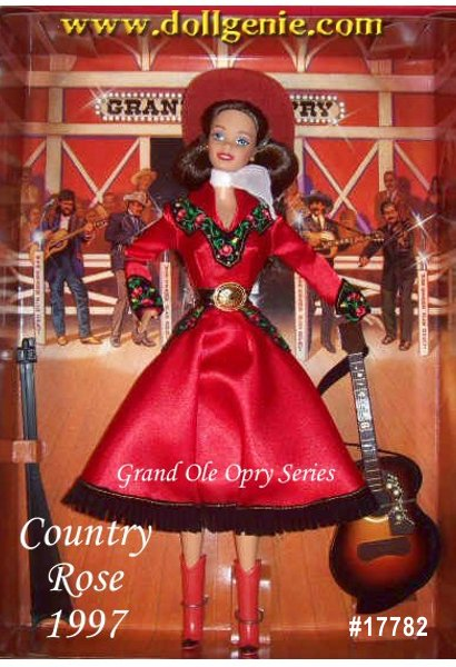 The premiere doll from the Grand Ole Opry Collection, Country Rose Barbie doll displays the style and glamour that made the Opry famous. Her stunning red satin ensemble is highlighted by black suede yolk and cuffs edged in golden trim. Beautiful embroidered roses, a white chiffon scarf and dazzling rhinestone accents add an elegant touch to her western outfit. From her rooted eyelashes and clear blue eyes, to her suede western hat, Barbie is simply show-stopping. She even has her own guitar.