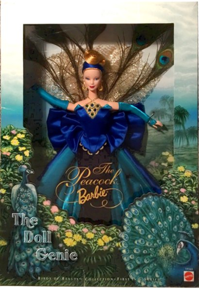 The Peacock Barbie doll is dressed in a striking sheath gown with a deep blue velvety skirt and an electric blue satin strapless bustier. The bodice is accented with green lining and is highlighted by a blue, green, and golden ornament. Her sheath has a striking overskirt of electric blue satin lined with green organza. A dramatic plumage of golden net and peacock feathers fans out behind Barbie and is secured at the hip by a draped satin bow.