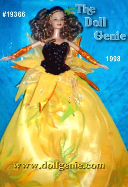 Shes as bright and as impressive as a sunflower in the field. Sunflower Barbie doll is dressed in a flowing gown of cream charmeuse with a Van Gogh sunflower print overlaid by a yellow chiffon petal skirt. Her brown velvety bodice is accented with sequins and beads to mimic the center of a sunflower. Flower petals of chiffon, organza, and metallic fabric encircle her wais tin shades of yellow, yellow-orange and orange with golden sparkle and are accented with iridescent sequins. She has delicate leaves of green and green satin tendrils falling from her waistline.