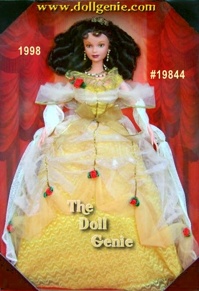 Disney Limited Edition Collector Doll- At last Beauty dances with the Prince who is no longer trapped inside the Beast. It is the beginning of living happily ever after. Black haired, green eyed Belle wears a ball gown inspired by the actual costume worn by the actress portraying Belle in the Broadway production of Beauty and the Beast. The costume itself was fashioned by interpreting history from the 18th century in Europe. From a shimmering crown of golden roses in Belles intricately-styled hair to the double-strand necklace and matching earrings fashioned of golden and silver-toned beads interspersed with faux pearls, attention to detail is evident. The fabrics selected for Belles ball gown include a tulle bodice, a scattering of vermillion roses and golden braid trim, along with a ivory lace shawl.