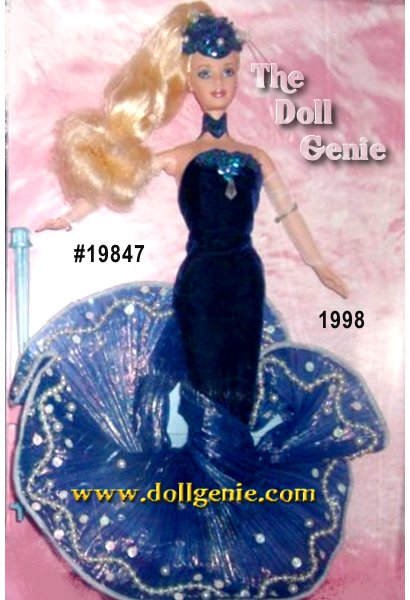 First in the Essence of Nature Collection inspired by the elements of nature, Water Rhapsody Barbie doll is a fantasy vision emerging from the water in her dark blue velvety sheath dress enhanced by a striking wave train of pleated iridescence with faux pearl and sequin detail. Her intricate scalloped sequin and bead headpiece features clear-beaded tendrils replicating the delicate sea spray. Her ensemble is complete with white mesh fingerless opera-length gloves and a wide blue bead and sequin choker.?