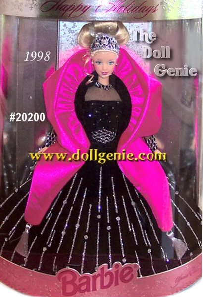 1998 Happy Holidays Barbie doll presents her sophistication and elegance dressed in a holiday theme gown in rich black velvety fabric with exquisite silver glitter accents - she is truly something special as the only doll in the series to wear black. A pink cape and jeweled tiara accent this stunning ensemble. As a bonus, this doll carries the distinction of the being the first in the Happy Holidays series to wear her hair styled in an elegant upsweep.