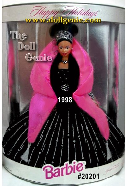 1998 Happy Holidays African American Barbie doll presents her sophistication and elegance dressed in a holiday theme gown in rich black velvety fabric with exquisite silver glitter accents - she is truly something special as the only doll in the series to wear black. A pink cape and jeweled tiara accent this stunning ensemble. As a bonus, this doll carries the distinction of the being the first in the Happy Holidays series to wear her hair styled in an elegant upsweep.