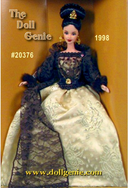 Renowned designer Oscar de la Renta has created a stunning and romantic gown exclusively for Barbie doll. A bodice of luxurious golden brocade is overlaid with chocolate colored lace and dazzled with sequins and beads. Elegant long lace sleeves ending in cuffs of faux fur cover her arms. This romantic gown features an opulent full skirt of golden brocade revealing an underskirt of tulle with golden edging. A lovely brown ribbon paired with a golden and faux topaz brooch accents the waist. Heightening the romance is a chocolate brown lace shawl, artfully draped around her arms. Barbie is the picture of style and elegance in Oscar de la Renta!?