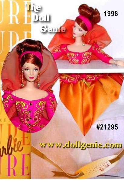 The last addition to the  breathtaking Barbie Couture Collection designed by Robert Best, Symphony in Chiffon Barbie doll is radiant in this rich combination of brilliant color and lavish fabrics. Her haute couture ensemble is captivating with a flowing cape of iridescent, deep orange chiffon with golden trim, the perfect rncomplement to her shimmering marigold satin skirt. Barbie dolls splendor is further enhanced by her fuchsia, silk shantung jacket, accented with sparkling crystals and golden embroidery stitches. Beautifully designed down to the last detail, even her golden pumps are decorated with crystals.