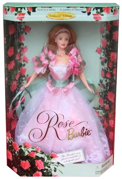 Rose Barbie - First in Series. Barbie wears an exquisite pink gown accented with roses. Large tow-tone ribbon cluster resembling roses decorate her sleeves, while a pretty lace panel highlights the satin bodice....Her rose print skirt has a charming white lace overskirt and a pale green sash tied at her waist. She carries a single pink