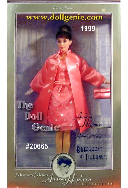 Collector Edition - This lovely Audrey Hepburn Barbie doll, the final in the Breakfast at Tiffanys series, is dressed in a delightful fashion Holly Golightly wore in the film. So charming, this party ensemble features a fabulous pink organza dress adorned with sequins and beads, with a soft pink satin underlining. The elegantly lined pink satin evening coat, handbag, white gloves and pink rhinestone tiara add the final splendid touches. A beautiful example of the amazing style that makes Audrey a legend.