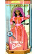 Moroccan Barbie doll is dressed in a beautiful authentically styled Moroccan orange and fuchsia dress. She wears a fuchsia chiffon veil and a head dress accented  with a golden coin in the center. Her lovely accessories include a golden necklace with one large coin, a golden hand ring and earrings and pink slipper-style shoes.