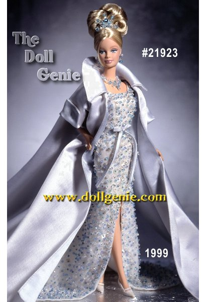 Crystal Jubilee Barbie was created for one very special occasion only - Barbie dolls 40th anniversary. The ensemble Barbie wears is a tribute to the timeless beauty of crystal. Made of soft white chiffon, her long, slim gown is lavishly encrusted with over two hundred and fifty dazzling hand-sewn Austrian crystals in sapphire blue, clear and aquamarine colors, creating a blaze of sparkle. Thousands of delicate hand-sewn bugle beads add richness and  shimmer. Barbie dolls fully lined skirt has a high slit in front and a rntrain in back. A striking full-length white satin opera coat with turned back sleeves and long train, fully lined in pale blue complements the exquisite gown. Her elaborate jewelry features a dazzling tiara of sapphire blue and clear crystals, drop crystal earrings with faux pearls, and a necklace with over thirty sapphire - blue and clear-colored crystals in rnfront. This doll is limited to 20,000 pieces worldwide and includes a numbered certificate of authenticity.