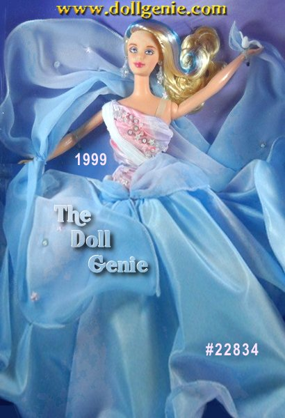 Second in the Essence of Nature Collection, Whispering Wind Barbie doll is a whirlwind of beauty. Fashioned in a fantasy garment reminiscent of a blustery breeze, her taffeta skirt features a liquid palette of sky blue and lilac hues swirling about. Her pleated bodice is printed in matching fluid tones and embellished with sparkling sequins. Attached to the dress is a sequined chiffon sash that flows to one side as though its swaying in a gentle breeze. Whispering Wind Barbie dolls long platinum blonde hair tastefully tinted with tiny strands of lilac and blue gracefully gusts to one side, while she holds a white dove in one hand.