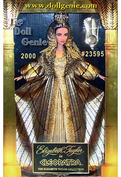Elizabeth Taylor as Cleopatra - her magnificent golden costume is re-created here in splendid detail. Cleopatras luxurious gown has a dramatic feather cloak that surrounds her like the wings of a bird. Her spectacular headdress features cobra symbols that protect royalty, a sun disk enclosed in horns, identifying her with the goddess Isis, and a large double feather representing cosmic harmony. The meticulous sculpting of our Cleopatra doll captures the stunning likeness of Elizabeth Taylor. Her face is painted so realistically that every detail is authentic to the movie - from the incredibly fine glitter eye shadow and heavy kohl liner to the exact shade of violet for her eyes. She is an amazing tribute to Elizabeth Taylor in one of her most glamorous roles.