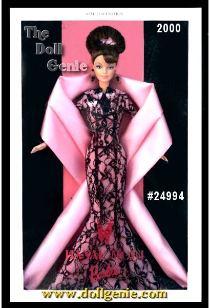 In a glamorous evening gown by the famous Japanese fashion designer, Hanae Mori Barbie doll is absolutely mesmerizing. An international haute couture masterpiece, Hanae Mori Barbie wears a magnificent black lace dress embellished with golden woven accents, pink taffeta butterflies, and black satin ribbons. A long and luxurious pale pink taffeta stole completes her fabulous, truly elegant look. This amazing doll is a Limited Edition, and the very first Barbie by this phenomenal, world-renowned designer.