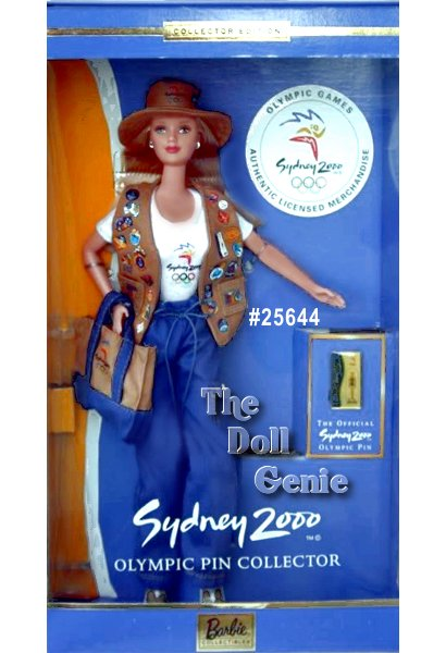 Sydney 2000 Olympic Pin Collector Barbie salutes the Sydney 2000 Olympic Games in her pin collector ensemble. She wears a tan pin collector vest adorned with printed reproductions of Sydney 2000 Olympic Games pins. A pin of the very same design is included with the doll for the collector. She also sports a white tee-shirt with the Sydney 2000 Olympic Games logo, sporty blue cargo pants and tan and white sneakers. She carries with her a tan tote bag complete with the Sydney 2000 Olympic Games logo. Barbie dons blond hair (African-American doll has black hair) and a tan hat. She is a true Aussie. blue charmeuse cape that is adorned with stars and stripes. This doll comes as either Caucasian or African American.