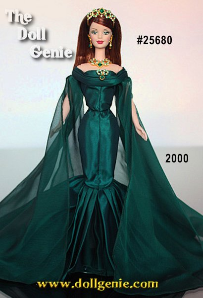 The premier doll in a spectacular Royal Jewels series paying tribute to the elegance and beauty of rare gems, Empress of Emeralds Barbie doll is an extraordinary tribute to her namesake jewel. Her magnificent emerald green taffeta and chiffon gown is the perfect backdrop for her exquisite jewelry. Made with painstaking attention to craftsmanship and quality, her jewelry showcases brilliant emerald-hued Swarovski crystals in dazzling designs. From her glistening tiara her lavish pendant, she is simply glorious.